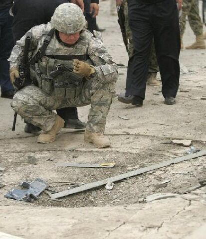 File:A-us-soldier-inspects-the-site-of-a-car-bomb-attack-in-kirkuk.jpg