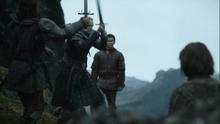 Podrick watches brienne and the hound.png