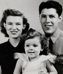 Baby Ann Dunham with parents Madelyn and Stanley c1945