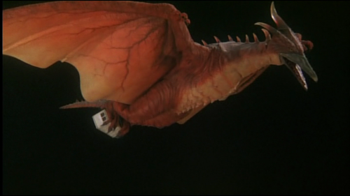 File:Fire Rodan carrying the container.png