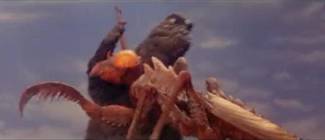 File:All Monsters Attack - Kamacuras number 2 fails his attack against Godzilla.png