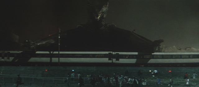 File:Gamera - 3 - vs Gyaos - 17 - Gyaos destroys the city and eats a few people.png