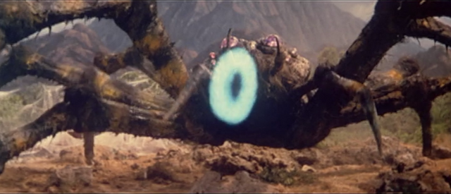 File:All Monsters Attack - Kumonga gets hit by a smoke ring which Minilla made.png