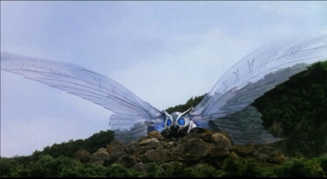File:RebirthIII-Armor Mothra developing wings.PNG