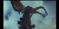 Ghidorah knocks over Godzilla