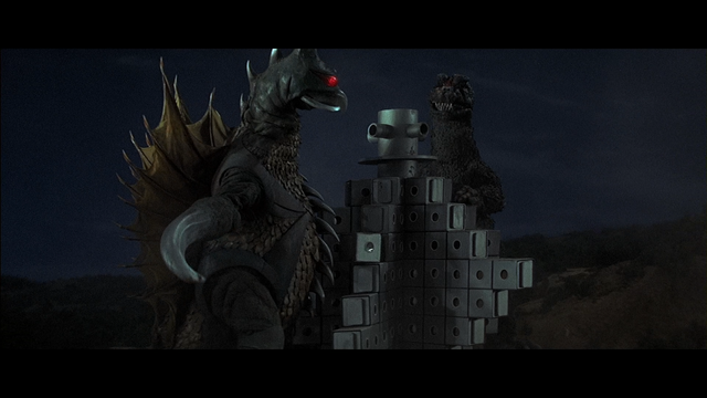 File:Godzilla and Gigan tear through a building a la King Kong vs Godzilla.png