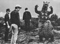 AMA - A Frightened Minilla and Gabara Infront of Three Men