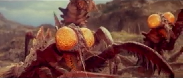 File:All Monsters Attack - Kamacuras appears in stock footage.png