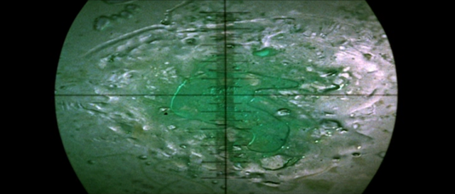 File:The H-Man - Screenshot - 13 - The H-Man is examined through a microscope.png