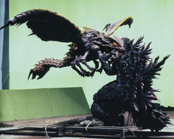 File:GXM - Megaguirus Bites Godzilla On Set.jpg