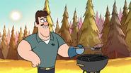S1e1 man grilling burger