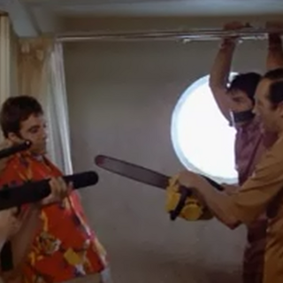 A screenshot of <i>Scarface</i>, from the scene that Apartment 3C parodies.