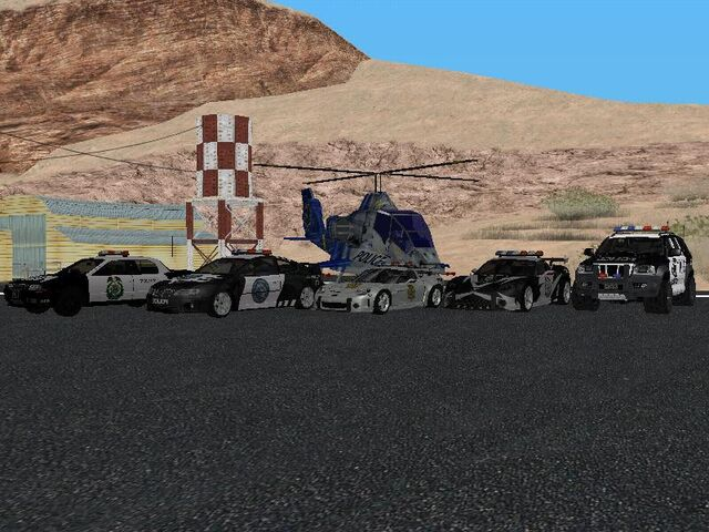 File:All Police Cars and Heli NFSMW Carbon.jpg