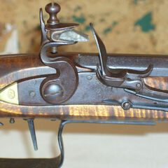 Close-up view of a flintlock before being fired.