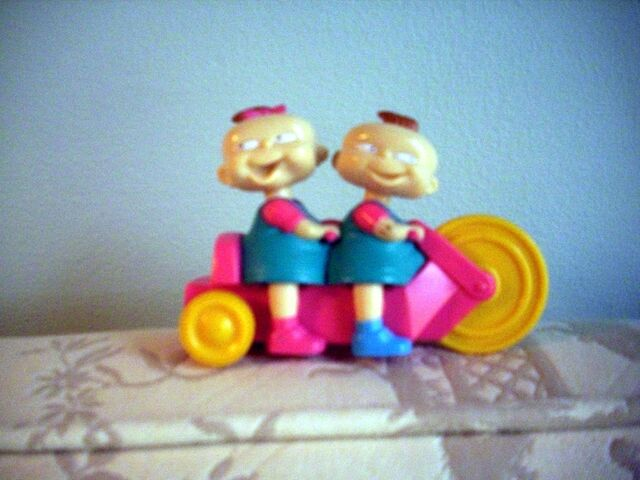 File:Phil and Lil on a trike toy.jpg