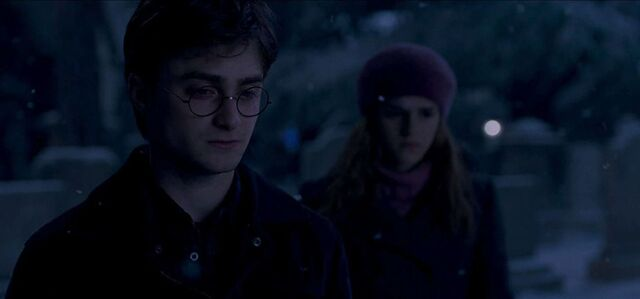 File:A teary Harry Potter with Hermione Granger at Godric's Hollow.jpg