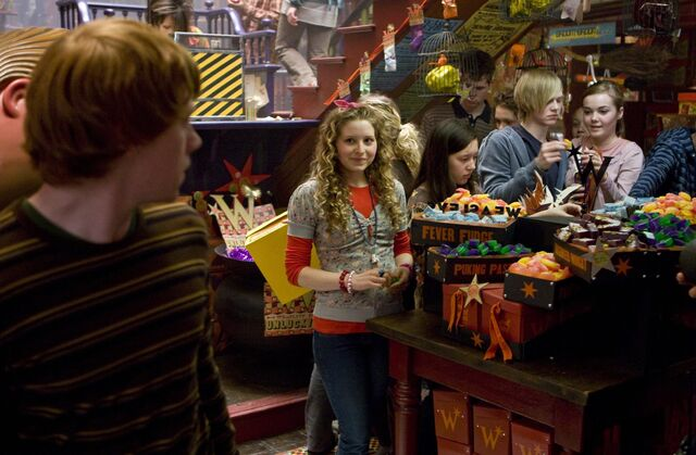 File:Lavender Brown looking at Ron inside WWW shop.jpg