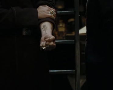 Bestand:Karkaroff showing Snape his mark.png