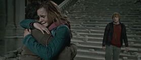 Harry and Hermione hug