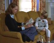 Laurie reads to Tommy
