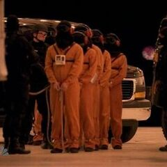 The prisoners being lined up (2nd, 3rd, 5th and 6th prisoners are Hiro, Tracy, female fugitive 2 and Sparrow Redhouse)