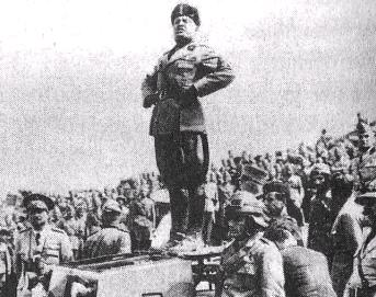 File:Mussolini standing on a tank.jpg
