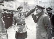Artur Axmann saluting Hitler