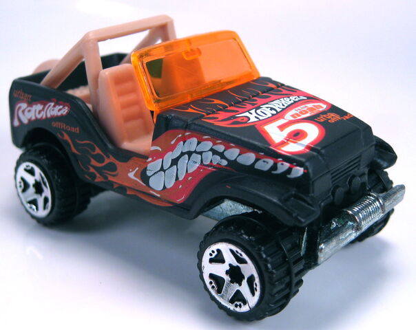 File:Trailbuster jeep flat black tan int ornage glass thailand 2002.JPG