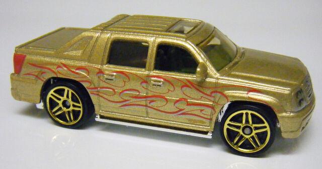 File:Escalade EXT - 09HHR-Gold.JPG