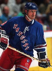 Hockey player in blue Rangers uniform