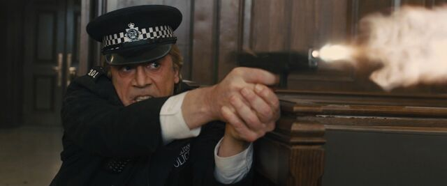 File:Skyfall - Silva firing his weapon during the hearing.jpg