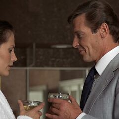 Bond and Miss Anders drink to their new partnership.