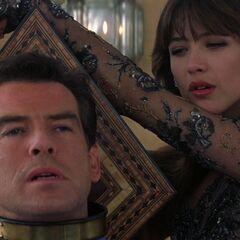 Elektra tortures Bond with an antique garotte