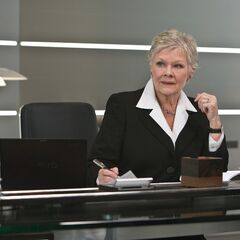 Promotional still of M in her office from <i>Quantum of Solace</i>.