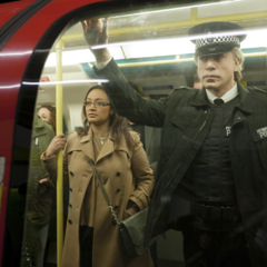 Silva on the London Underground Tube, disguised as a police officer.