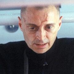 Renard prepares to insert the plutonium rod into the reactor.