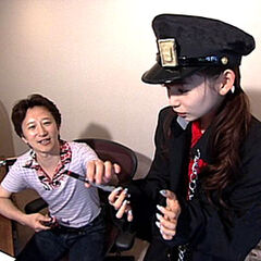 Shoko interviewing Araki while cosplaying as <a href=
