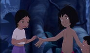 Mowgli is asking Shanti if he can hold her hand