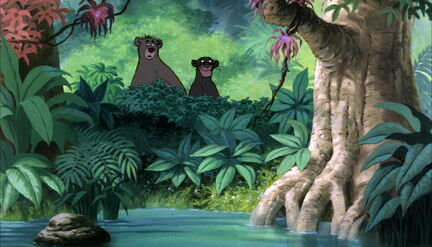 Baloo the Bear and Bagheera The Black Panther are both watching Mowgli leave