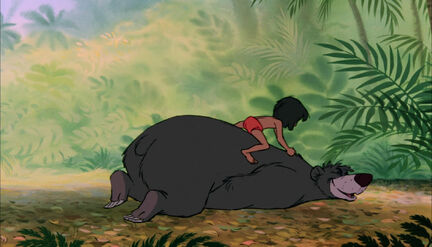 Mowgli is tickling Baloo the bear