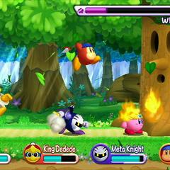 Los cuatro jugadores atacando a Whispy Woods.