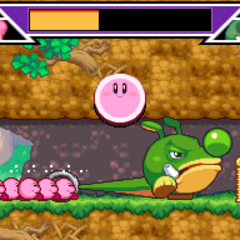 Varios Kirbys atacando a un gran enemigo.