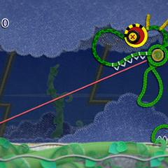 Kirby luchando contra el jefe <b>Dragruñón</b>.