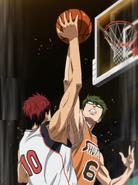 Kagami and Midorima jump to get the shot
