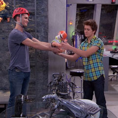 Adam gives Chase one of his plastic babies