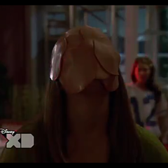Caitlin's face covered