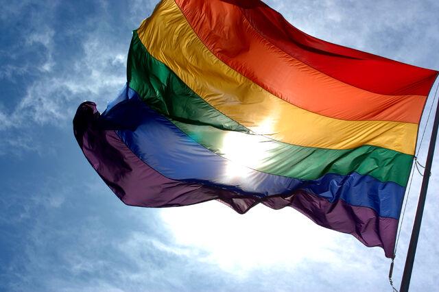 File:Rainbow flag and blue skies.jpg
