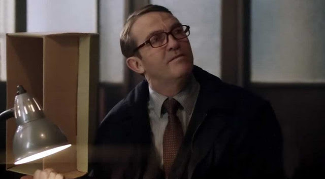 File:Ronnie in the police archive in Survivor's Guilt.jpg