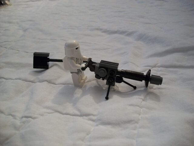 File:Snowtrooper Manning Repeating E-blaster.jpg