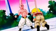 Krillin trapped by buu